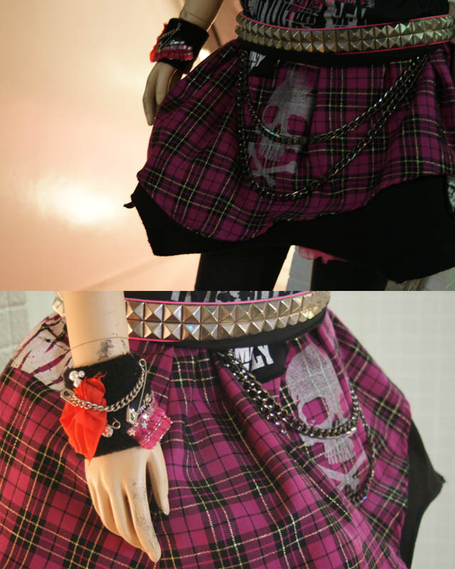 Pink punk plaid skirt, studded belt with chains. Wrist band, hot topic style with badges, safety pins. Sex Pot Revenge, Harajuku Gothic Lolita Punk store. Shopping for Lolita fashion in Tokyo, Japan.