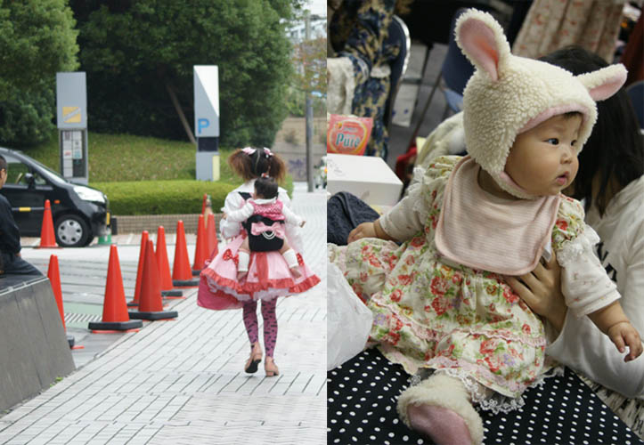 Baby lolitas, little toddler kid in bunny ears costume. Japanese girl carrying baby on back, dressed in crazy outfit. Alamode Market, Gothic Lolita shopping and small designer boutiques, presented by D's Valentine in Tokyo Japan.